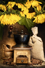 Stiill life with Antique coffee grinder and sunflowers