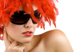 woman with red feather wig and sunglasses poster