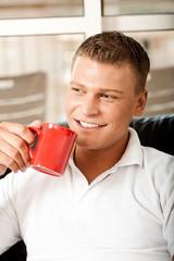 Handosme guy enjoying coffee