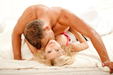 Intimate couple during sexual intercourse