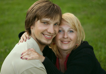 Husband and wife on grass background