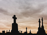 Crosses silhouettes against a colored cloudy sky