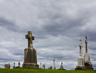 Crosses against a cloudy sky