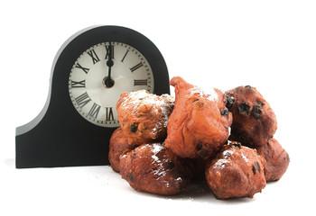 dutch oliebollen withe clock