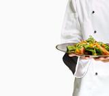 Chef holding salad