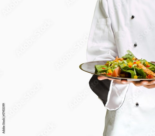 Chef holding salad