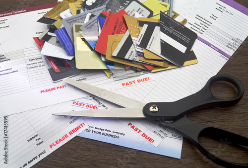 Overdue Bills with Scissors and Cut Up Credit Cards