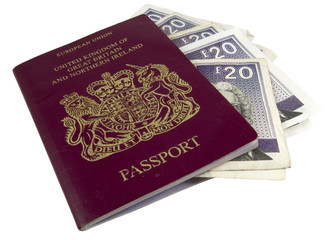 british passport with 100 pounds cash on white background