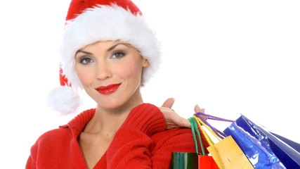 Sexy girl in santa claus hat with shopping bags