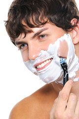 Portrait of handsome man shaving his face