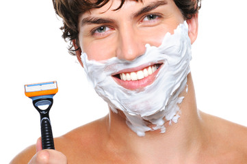 Happy male face with razor over white