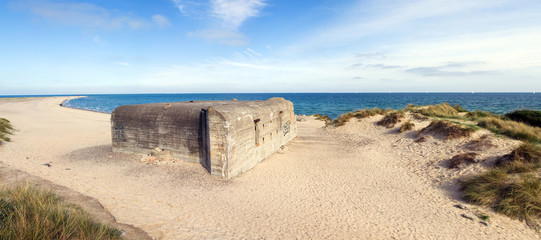 German war bunker on beach by sea