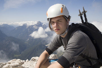 mountaineer on the summit  in Julian alps - Slovenia