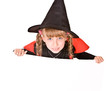 Child girl in Halloween witch costume with banner.