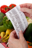 Grocery receipt over a bag of vegetables poster