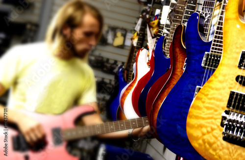 Man at guitar store