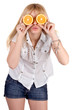 Portrait of the funny girl with oranges. Isolated