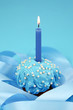 Birthday cake on blue background
