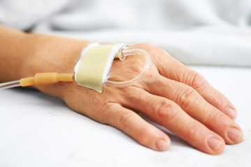 Old woman hand with IV