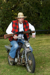 Redneck Motorcyle Riding with a Shotgun