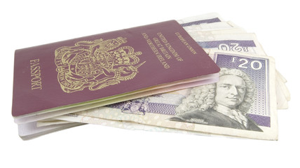 single british passport with cash isolated on white