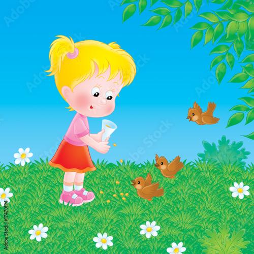 Little girl feeds the birds