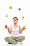 Asian woman juggling fruits poster