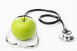 Green apple and stethocscope