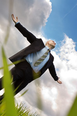 happy businessman embraces the sky