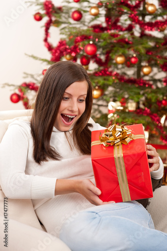 Surprised woman with Christmas gift