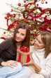 Two smiling women with Christmas present