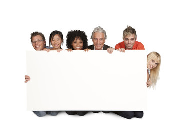 Group of happy students and lecturer holding white board