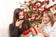 Two women unpacking Christmas present