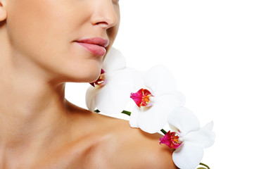 flower on the shoulder of the woman with clean healthy skin