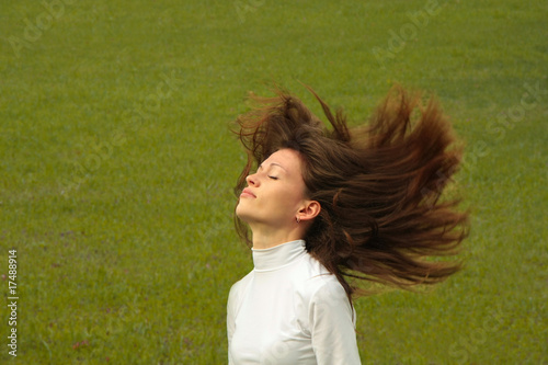 girl in nature. Motion hair