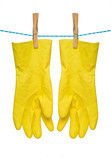 Pair of yellow gloves drying on rope