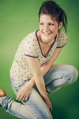 smiling young woman brunette on  green background