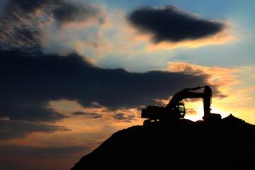 skyline excavator with colored sunset