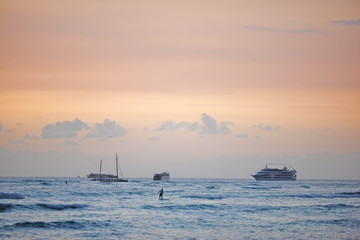Sunset and boat - the Pacific Ocean outside Waikiki Beach