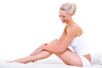 Caucasian woman stroking her beauty legs