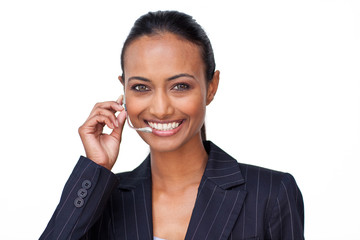 Smiling Indian businesswoman talking on a headset