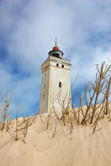 Lighthouse in desert by the sea - Jutland, Denmark