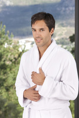 athletic man in towel at spa