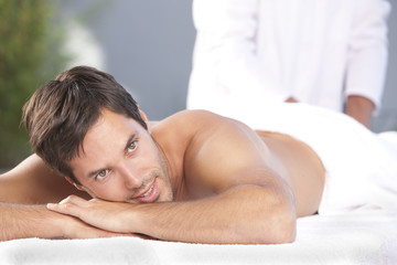 man lying on the towel