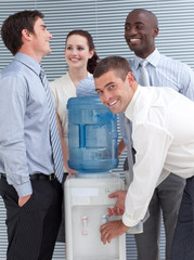 Businesspeople standing around water cooler