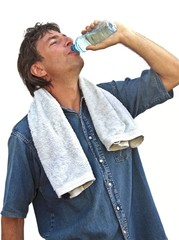 Young sports man drinking water