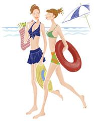 水着を着て砂浜を歩く女性
