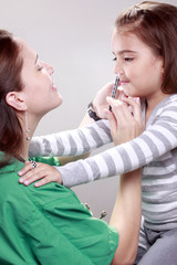 Preteen gets a swine flu shot from her doctor