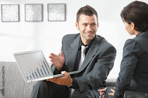 Businessman showing grapth on computer