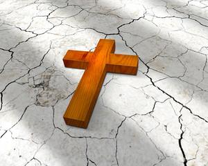 wooden cross lying on cracks